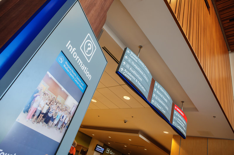 hospital information digital directory and hanging wayfinding sign