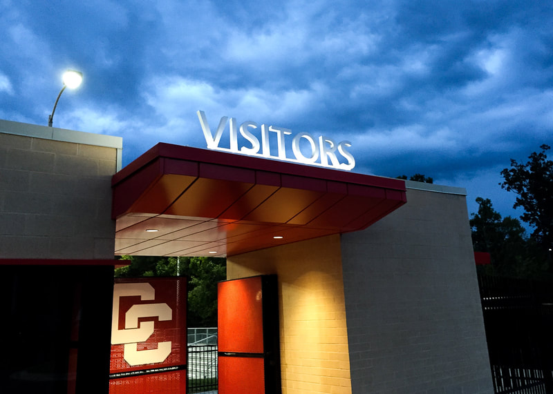 high school stadium entrance lettering illuminated
