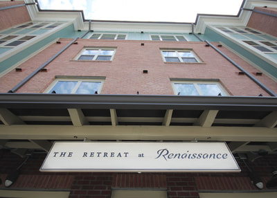 the retreat at renaissance hanging sign