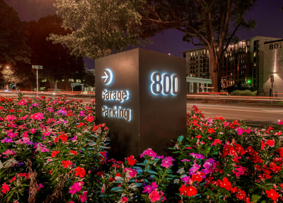 exterior reverse illuminated wayfinding parking monument