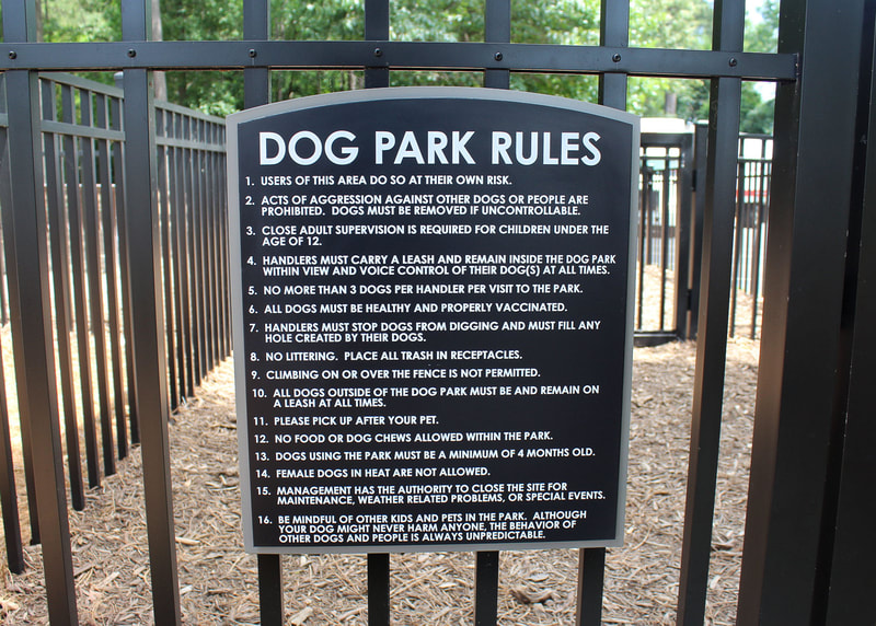 Exterior dog park rules fence sign
