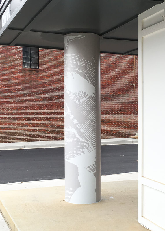 Wall graphics on exterior column