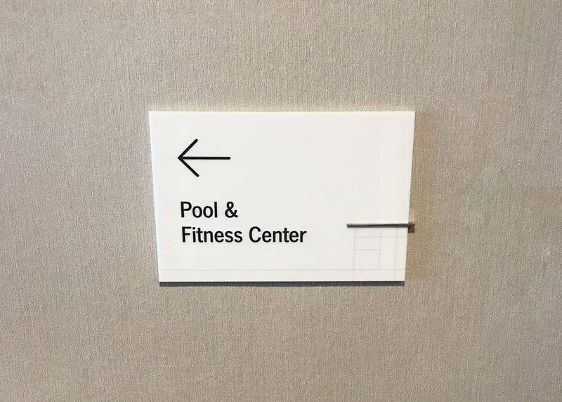 Wall mounted wayfinding hotel sign