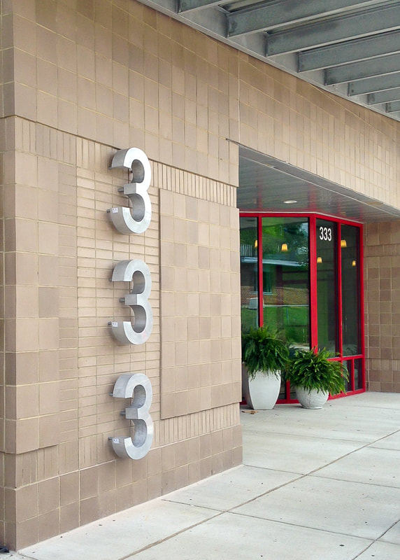 Exterior wall mounted metal address numbers