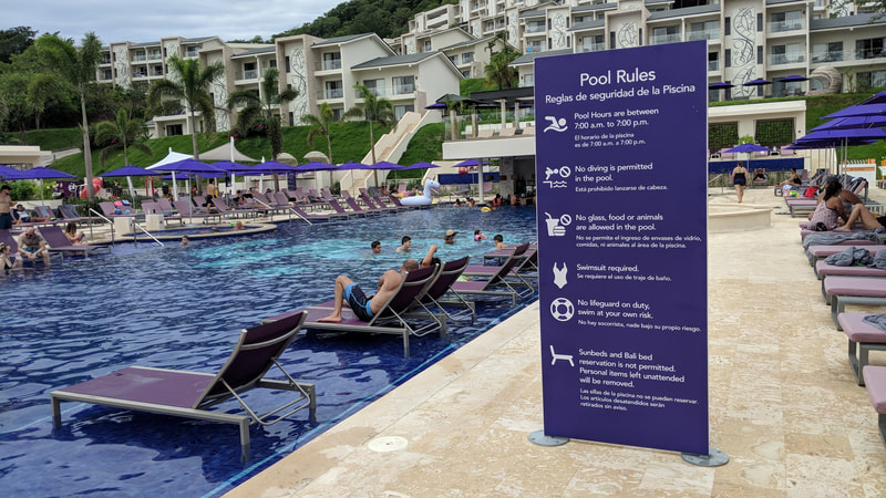 hotel pool rules sign