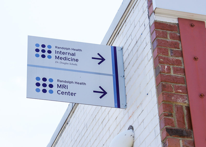exterior hospital wayfinding double sided sign
