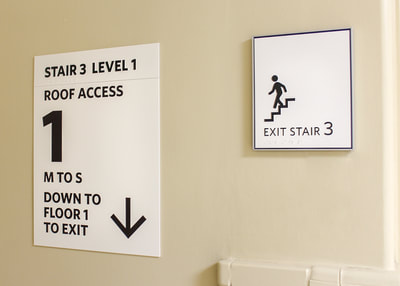 ada wall mounted exit code sign stairs