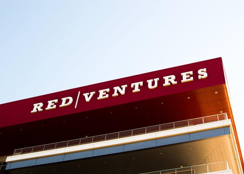 Red Ventures exterior wall mounted logo