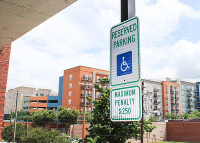 hanging reserved handicap parking garage sign