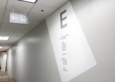 hanging wayfinding sign and wayfinding wall graphics