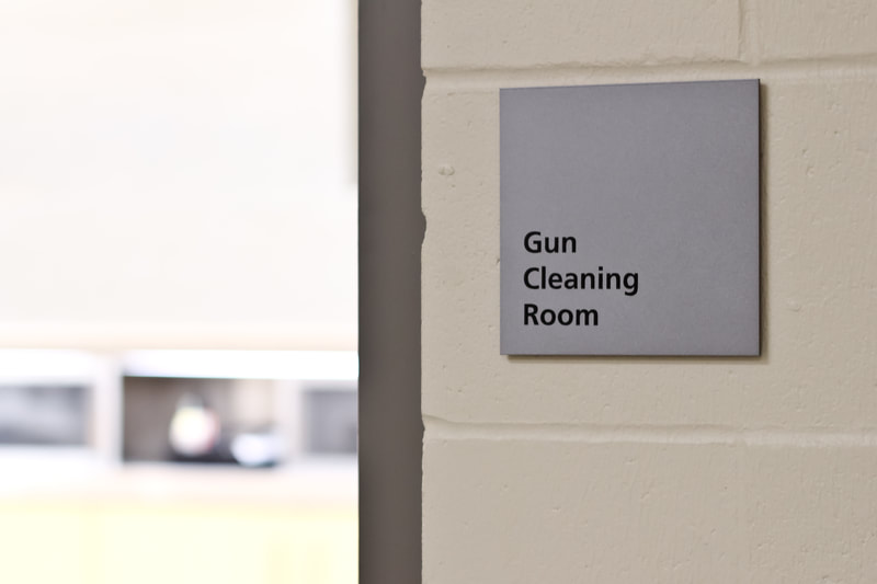 Wall mounted identification sign
